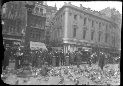 Feeding the pigeons at St Paul's Churchyard, London, c.1920s