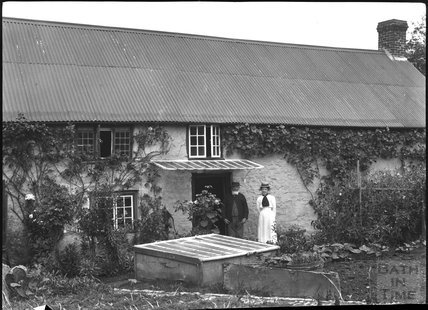 Unidentified man and woman in Post Office garden, c.1900s