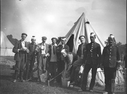 Soldiers and civilians at military camp, c.1910s