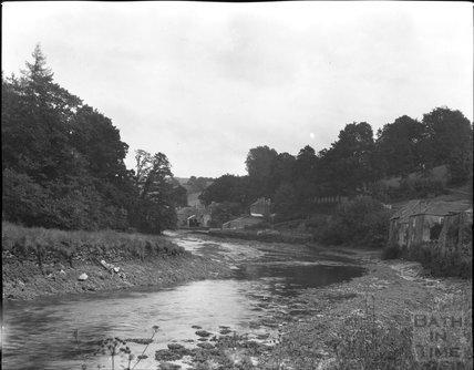 Unidentified riverside village, c.1900s