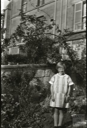 unidentified girl in garden, c.1950s