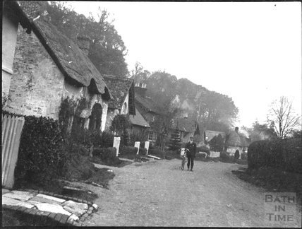 Cyclist in an unidentified village street, c.1900s