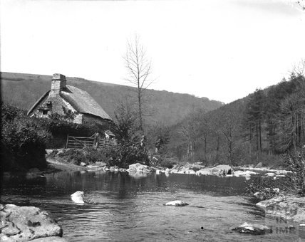 Cottage by an unidentified river, c.1900s