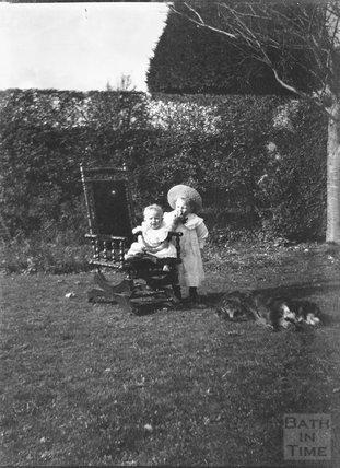 Children in a rocking chair, c.1900s