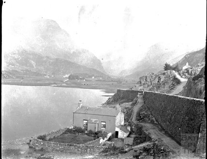 Cottage on a lake in an unidentified location, possibly in North Wales, c.1900s