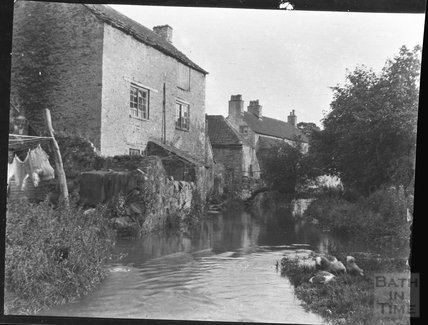 Stream and buildings in Nunney, c.1950s