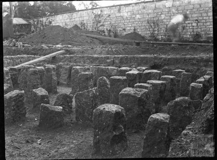 Excavation of what looks like a hypocaust in a walled garden in an unknown location c.1900s