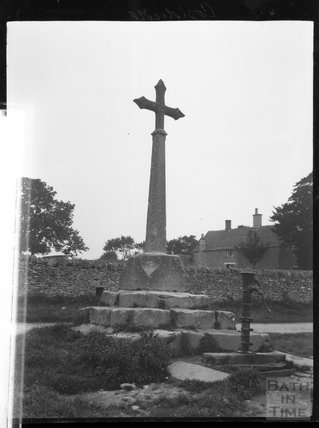 Village cross and pump in unknown location c.1900s