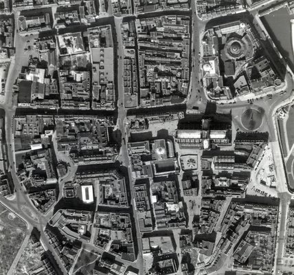 1947 Aerial Photograph showing The Abbey, Stall Street and the distinctive shape of the Old City. Taken 12th April