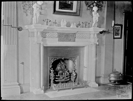 Unidentified Fire Place, with cherubs and ornate wall carvings, c.1905