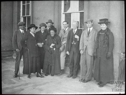 Group Portrait outside unidentified building, c.1905