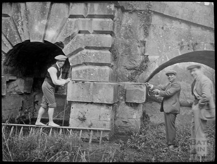 Stonemasons/Surveyors measuring part of the Palladian Bridge, Prior Park c.1905