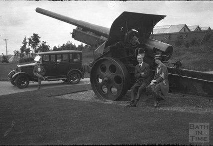 Posing beside an artillery gun, c.1930s