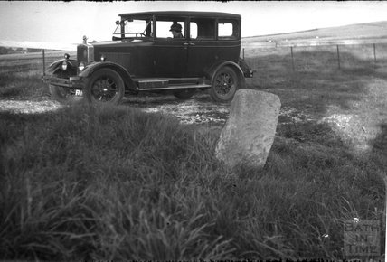 The photographer's car and a roadside interesting stone, c.1930s