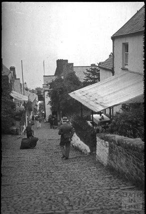 Descending the cobbles at Clovelly North Devon, c.1930s