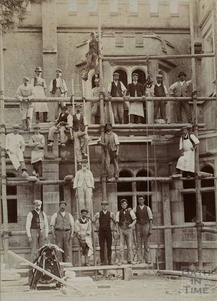 A group of builders in front of an unidentified castellated building, probably in the Bath area, c.1880s