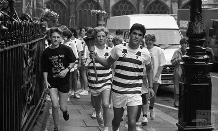 Students run through Bath with an Olympic torch, September 1991