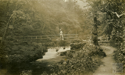 The photographer's wife Violet on a bridge over the river Lyn, Lynmouth, c.1910