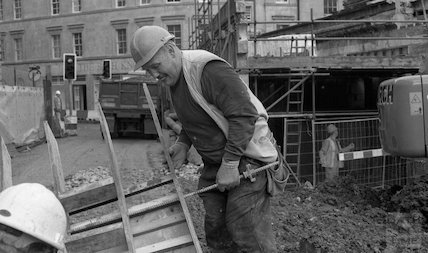 A worker, concentrating at the Thermae Bath Spa development, 4 April 2001