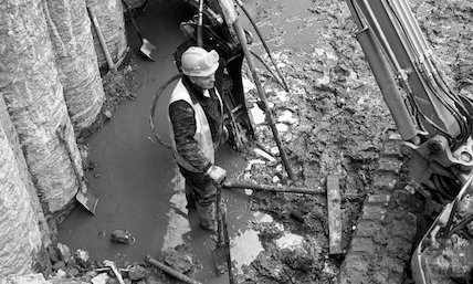 A workman stands in the watery basement of the Thermae Bath Spa development, 4 April 2001