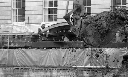 A digger moving soil from the Thermae Bath Spa development, 4 April 2001