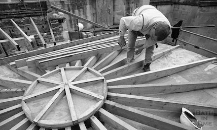 A construction worker fitting the roof to the Cross Bath, 3 May 2001
