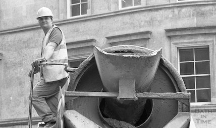 A construction worker and his cement mixer at the site of the Thermae Bath Spa, 3 May 2001