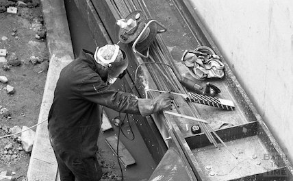 A welder at work on the construction site of Thermae Bath Spa, 11 May 2001