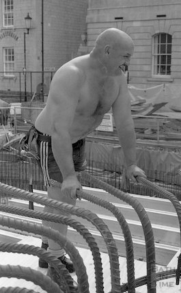 A workman at the Minerva Bath whilst it is under construction for Thermae Bath Spa, 1 September 2001