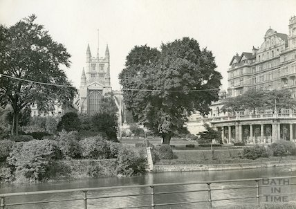 View of Bath Abbey from river showing Parade Gardens