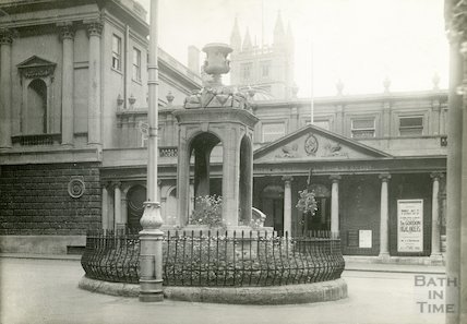 Mineral Water Fountain, Stall Street. From East End of Bath Street showing Queen's Bath and Pump Room, c.1930?