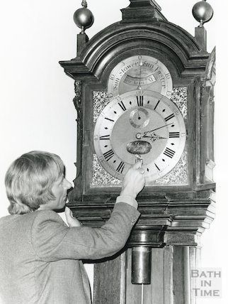 Tompion Clock in Pump Room being wound up by Sam Hunt, Bath Museum curator 1984