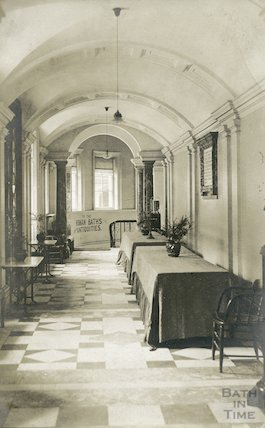 Pump Room - view in the corridor showing entrance to the Roman Baths, c.1920