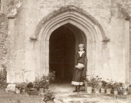 A girl posing in South Wraxall Manor entrance porch c.1885 - detail