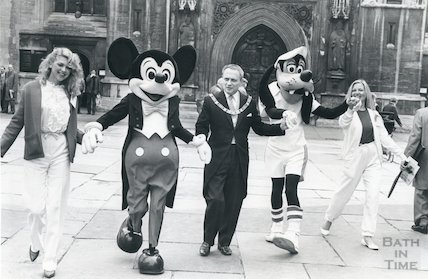 Mayor of Bath with Mickey Mouse in Abbey Churchyard, 1983