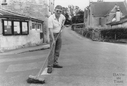 Roland Birchby sweeping the road in Freshford, 28 July 1988