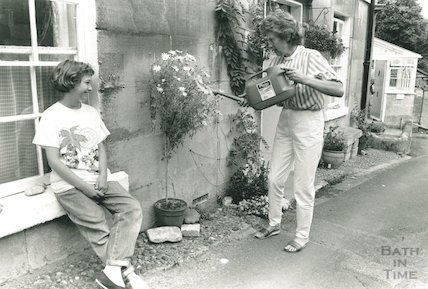Tessa and Eleanor Moriaty outside their house in Freshford, 2 August 1988