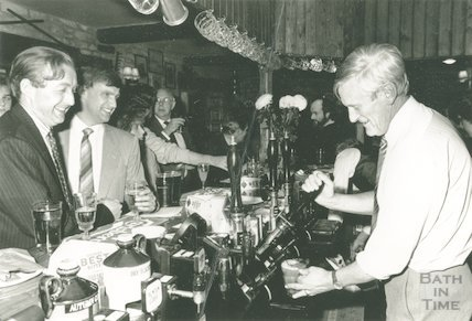 Patrick Padfield pulls pints at the Inn at Freshford, 1988
