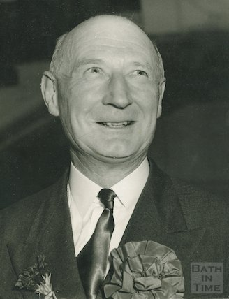 Sir James Pitman celebrating victory on election night, c.1950s