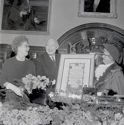Sir James Pitman presented with a certificate of thanks on his retirement as Bath's MP, January 1965