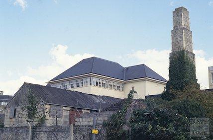 Derelict buildings and chimney, next to T Davis, Milk Street, October 1993