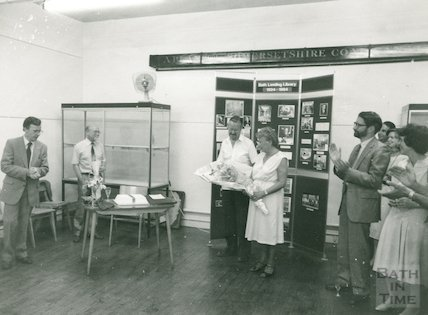 Area Librarian, Mr Kite, presents Mr Macrae with retirement gift, July 1984