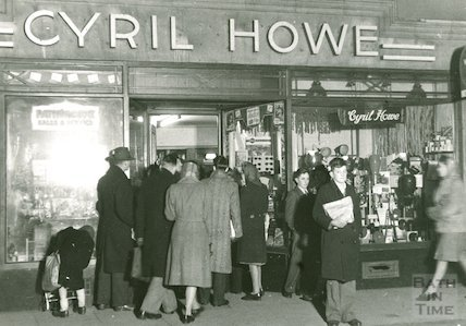 A crowd of customers outside Cyril Howe, photographer (probably 14 Cheap Street ), 1950s
