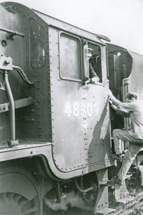 Climbing aboard Engine  No.48309, c.1960