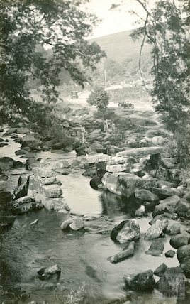 Unidentified stream with ancient stone bridge, possibly Dartmoor, c.1920s