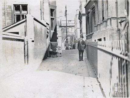 Postman and twin girls with pram, Bridewell Lane, Bath, c.1920s