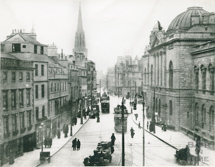 High Street with Guildhall on right with trams, c.1920s