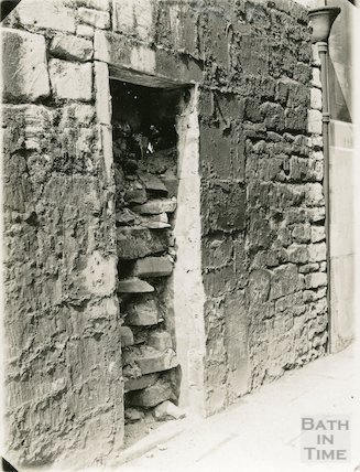 Watchman's hut in the wall of Fountain Buildings, Lansdown Road during demolition, 1934