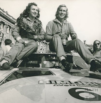 James Hunt and co-driver on the roof of their rally car outside the Royal Crescent, July 1973