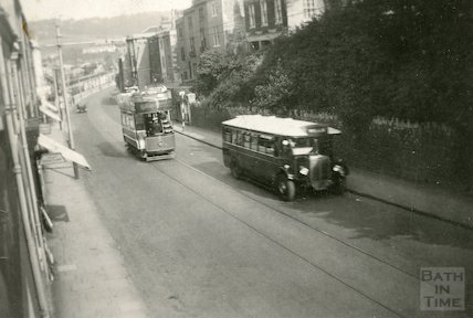 A tram and bus appear to race up the Wells Road, Bath, 1936
